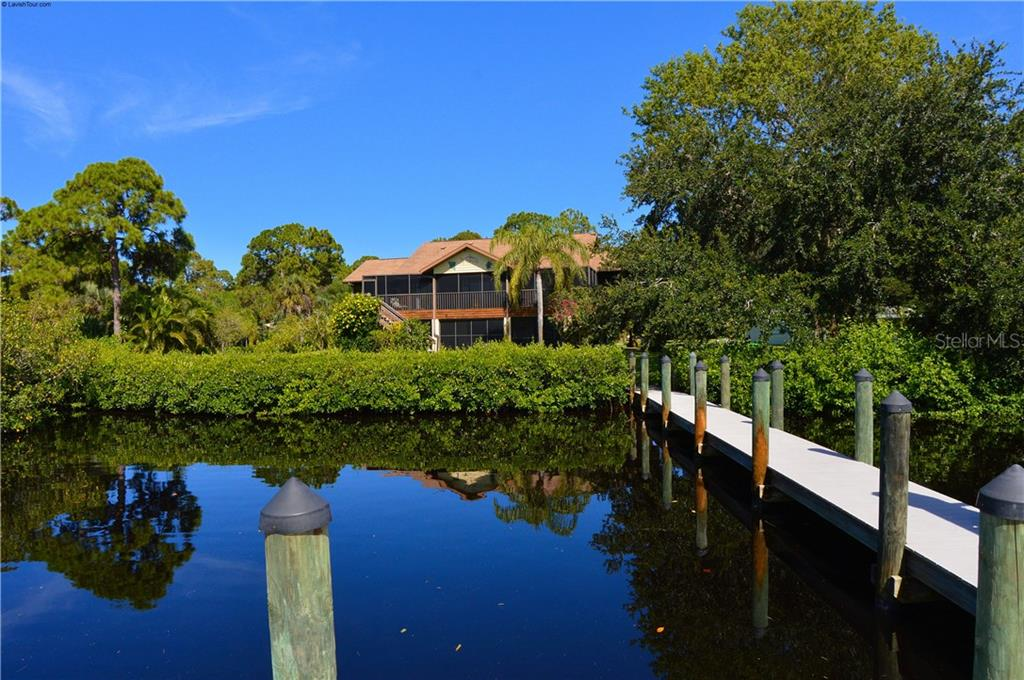 View of house from dock - Single Family Home for sale at 1649 Manor Rd, Englewood, FL 34223 - MLS Number is N5914466