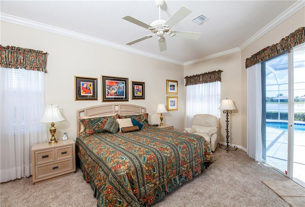 Master Bedroom with Slider to Lanai - Single Family Home for sale at 366 Turtleback Xing, Venice, FL 34292 - MLS Number is N5914504