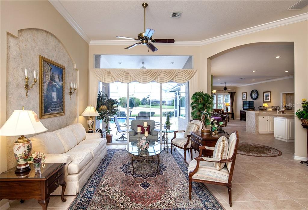 From Foyer through Living Room to Kitchen & Family Room - Single Family Home for sale at 366 Turtleback Xing, Venice, FL 34292 - MLS Number is N5914504