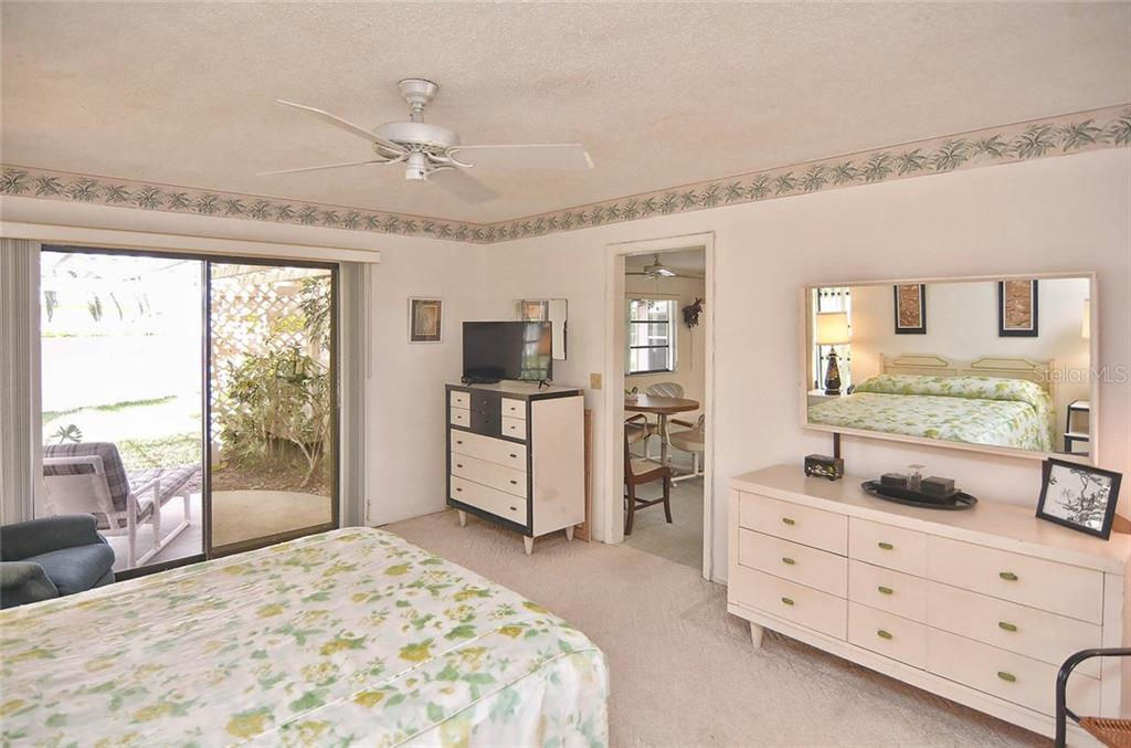 Master bedroom with sliders to patio - Single Family Home for sale at 1410 Strada D Argento, Venice, FL 34292 - MLS Number is N5914540