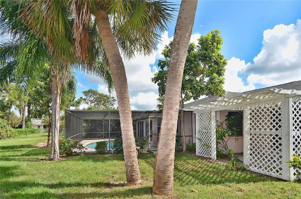 Rear exterior - Single Family Home for sale at 1410 Strada D Argento, Venice, FL 34292 - MLS Number is N5914540