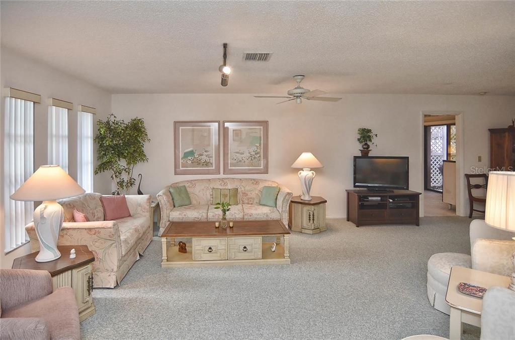 Living room - Single Family Home for sale at 1410 Strada D Argento, Venice, FL 34292 - MLS Number is N5914540