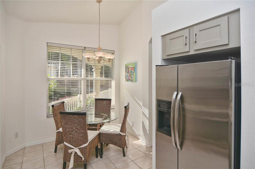 Breakfast nook from kitchen. - Single Family Home for sale at 498 Meadow Sweet Cir, Osprey, FL 34229 - MLS Number is N5914789