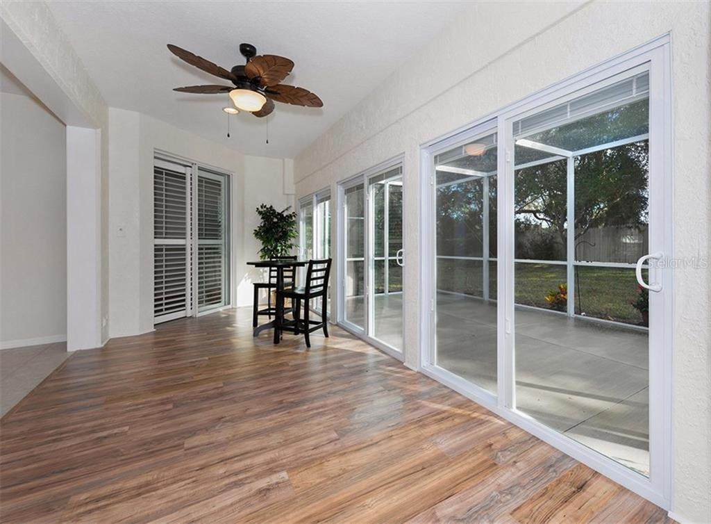 Sliders to lanai - Single Family Home for sale at 2196 Calusa Lakes Blvd, Nokomis, FL 34275 - MLS Number is N5915879