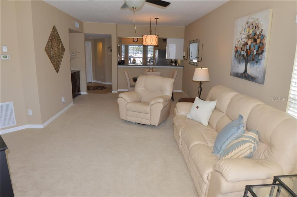 Living room/dining room to foyer and kitchen - Condo for sale at 903 Addington Ct #102, Venice, FL 34293 - MLS Number is N5916962
