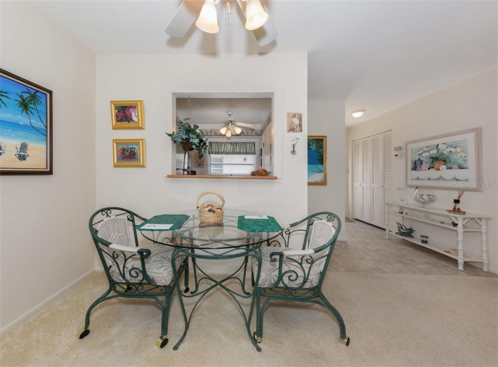 Dining nook area. - Condo for sale at 100 The Esplanade N #4, Venice, FL 34285 - MLS Number is N6100334