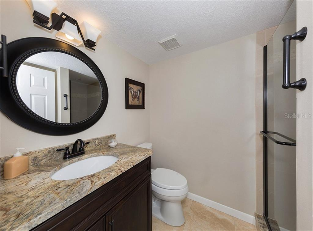 Guest bathroom has been completely updated: new vanity, flooring, tile shower and hardware. - Condo for sale at 500 Park Blvd S #67, Venice, FL 34285 - MLS Number is N6100360