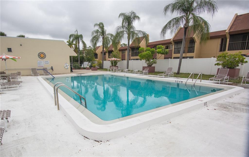 Community pool - Condo for sale at 519 Albee Farm Rd #117, Venice, FL 34285 - MLS Number is N6100461