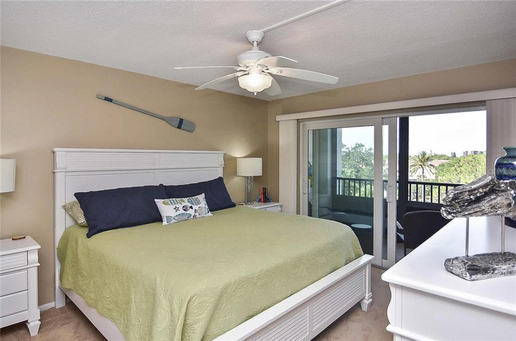Master bedroom with sliders to lanai - Condo for sale at 512 W Venice Ave #506, Venice, FL 34285 - MLS Number is N6100462