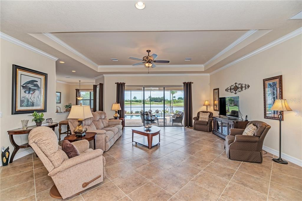 Living area with tray ceiling and crown molding - Single Family Home for sale at 20145 Cristoforo Pl, Venice, FL 34293 - MLS Number is N6100537