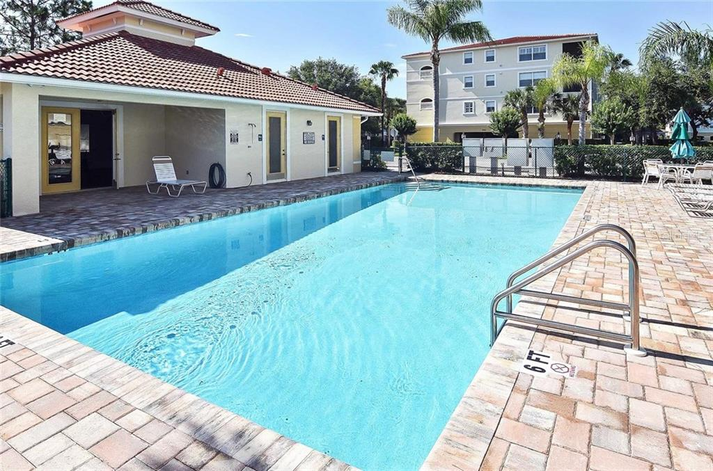Community pool/clubhouse - Condo for sale at 940 Cooper St #202, Venice, FL 34285 - MLS Number is N6101184