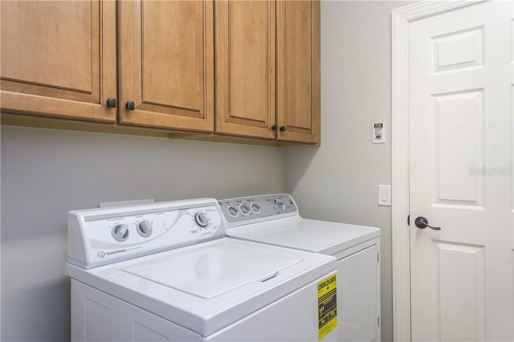 Laundry with Wood Cabinetry - Single Family Home for sale at 2290 Terracina Dr, Venice, FL 34292 - MLS Number is N6101301