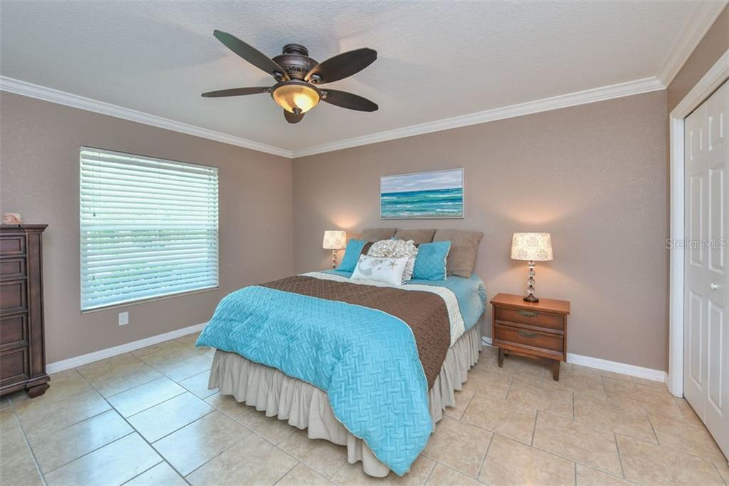 Guest house bedroom - Single Family Home for sale at 9150 Deer Ct, Venice, FL 34293 - MLS Number is N6101408