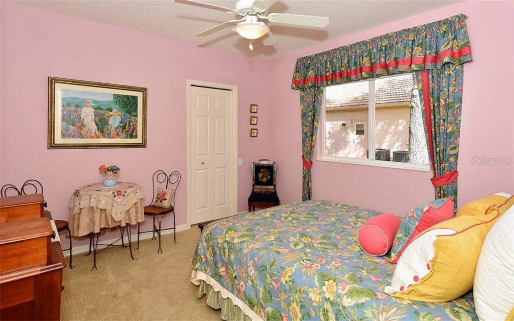 Bedroom 2 - Single Family Home for sale at 913 Chickadee Dr, Venice, FL 34285 - MLS Number is N6101770