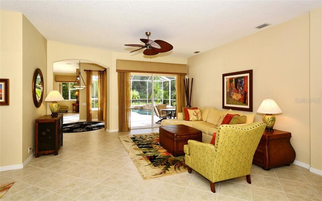 Living room - Single Family Home for sale at 913 Chickadee Dr, Venice, FL 34285 - MLS Number is N6101770