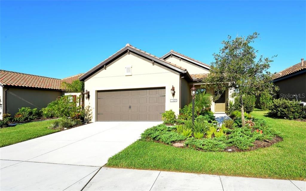 Front of homes with sidewalks - Single Family Home for sale at 221 Alfero Way, Nokomis, FL 34275 - MLS Number is N6102041