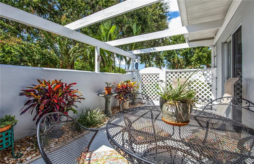 Another view of front terrace, such a private and peaceful setting. - Villa for sale at 206 Cerromar Way S #25, Venice, FL 34293 - MLS Number is N6102127