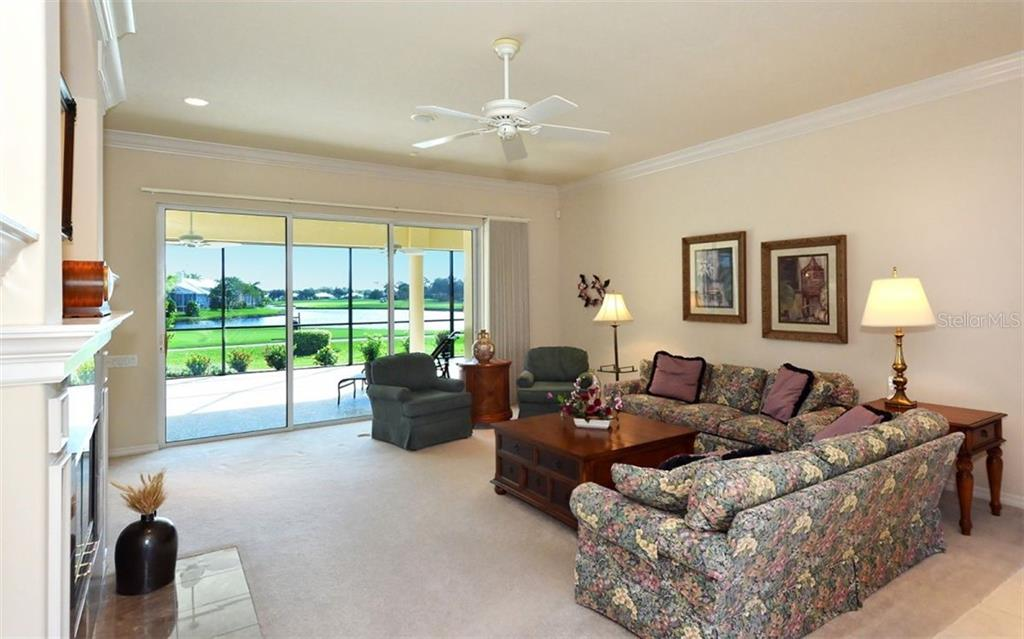 Great room - Single Family Home for sale at 979 Chickadee Dr, Venice, FL 34285 - MLS Number is N6102266