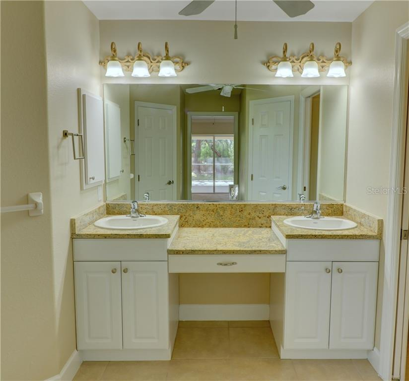Master bathroom has double vanity with makeup area and granite counters - Single Family Home for sale at 409 Palm Ave, Nokomis, FL 34275 - MLS Number is N6102313