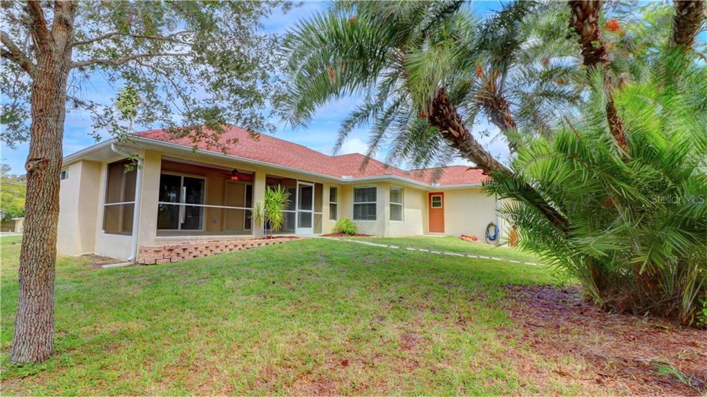 Plenty of room for a pool (NOTE:  Door on right leads to small hallway and bathroom 3, perfect for a pool bath) - Single Family Home for sale at 409 Palm Ave, Nokomis, FL 34275 - MLS Number is N6102313
