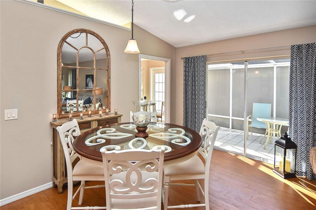 Dining area to lanai - Villa for sale at 719 Brightside Crescent Dr #36, Venice, FL 34293 - MLS Number is N6102753
