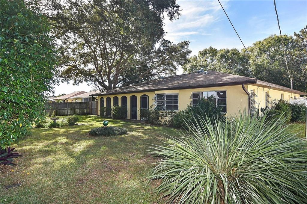 Back of house - Single Family Home for sale at 1885 Neptune Dr, Englewood, FL 34223 - MLS Number is N6103051