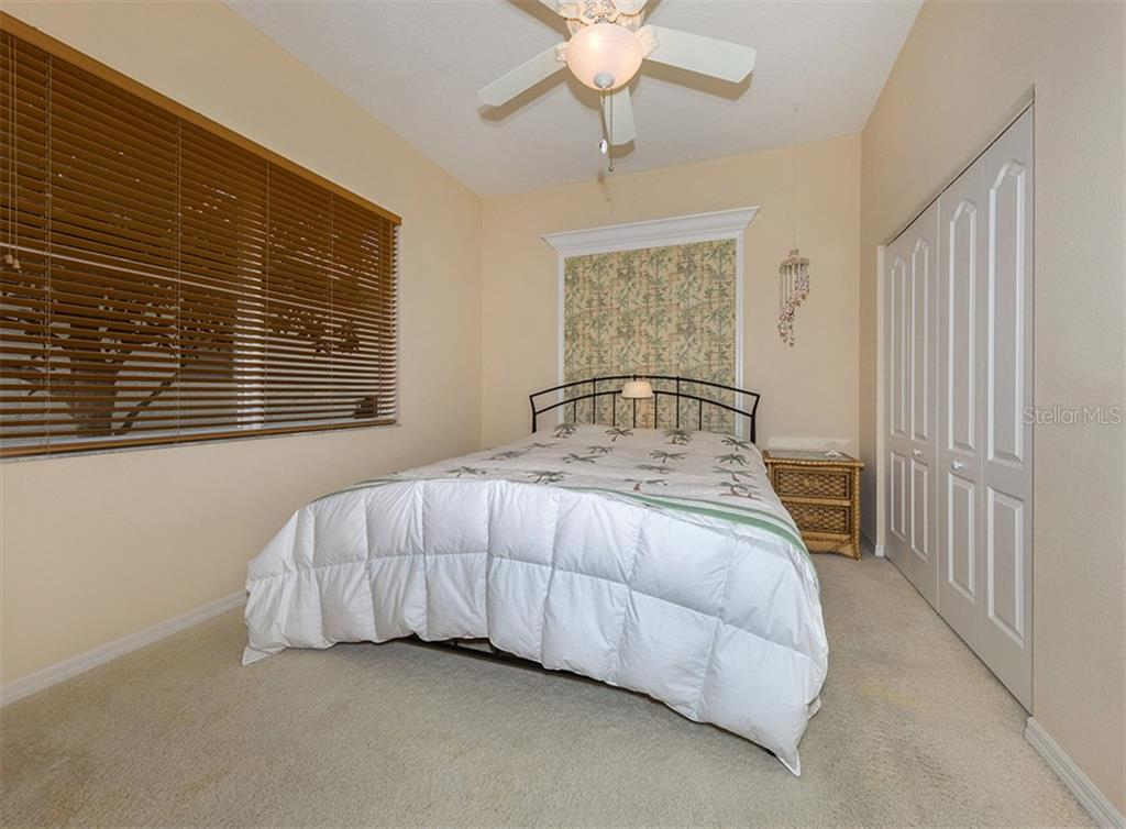 Bedroom 2 - Single Family Home for sale at 627 Lakescene Dr, Venice, FL 34293 - MLS Number is N6103268