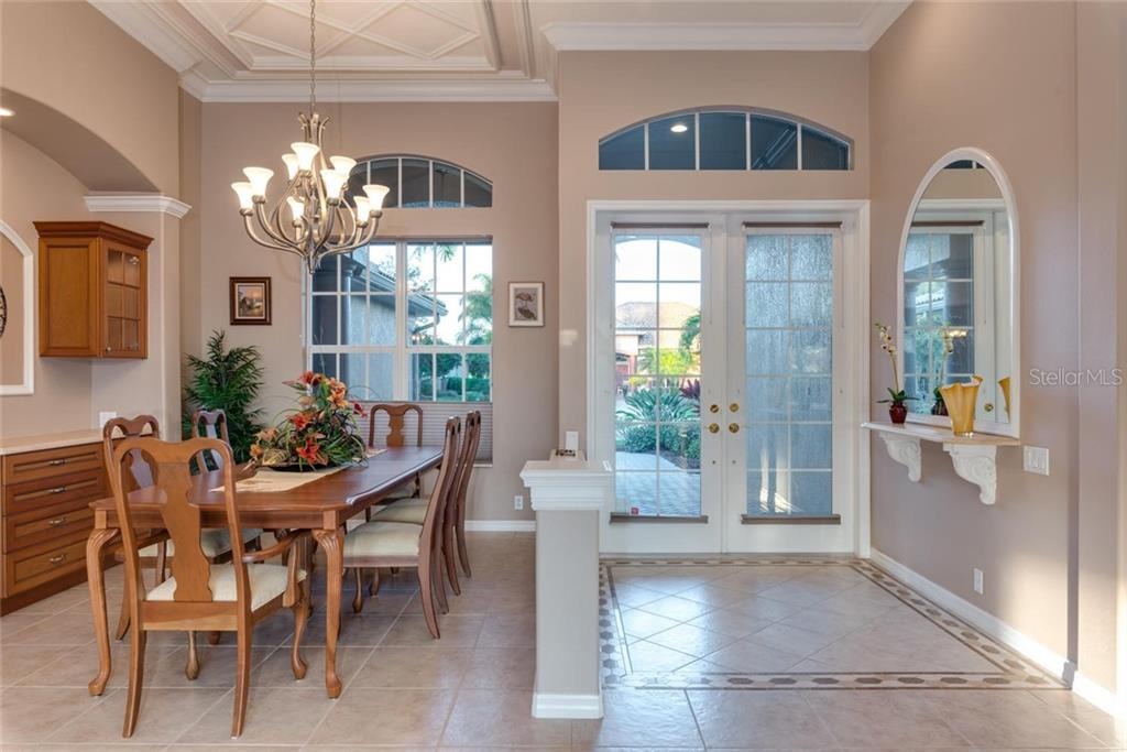Dining room, foyer - Single Family Home for sale at 821 Adonis Pl, Venice, FL 34292 - MLS Number is N6104303