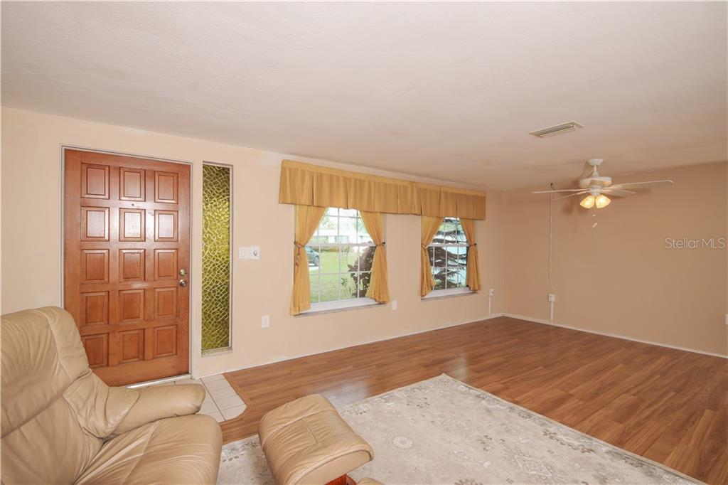 Living Room Area - Single Family Home for sale at 41 Caroll Cir, Englewood, FL 34223 - MLS Number is N6104860