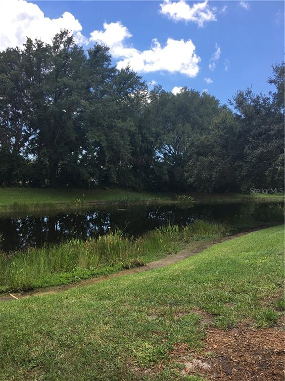 Pond view.  Whistling wood ducks and Ibis frequent this pond. Big mouth bass was caught recently! - Villa for sale at 572 Clubside Cir #34, Venice, FL 34293 - MLS Number is N6105221