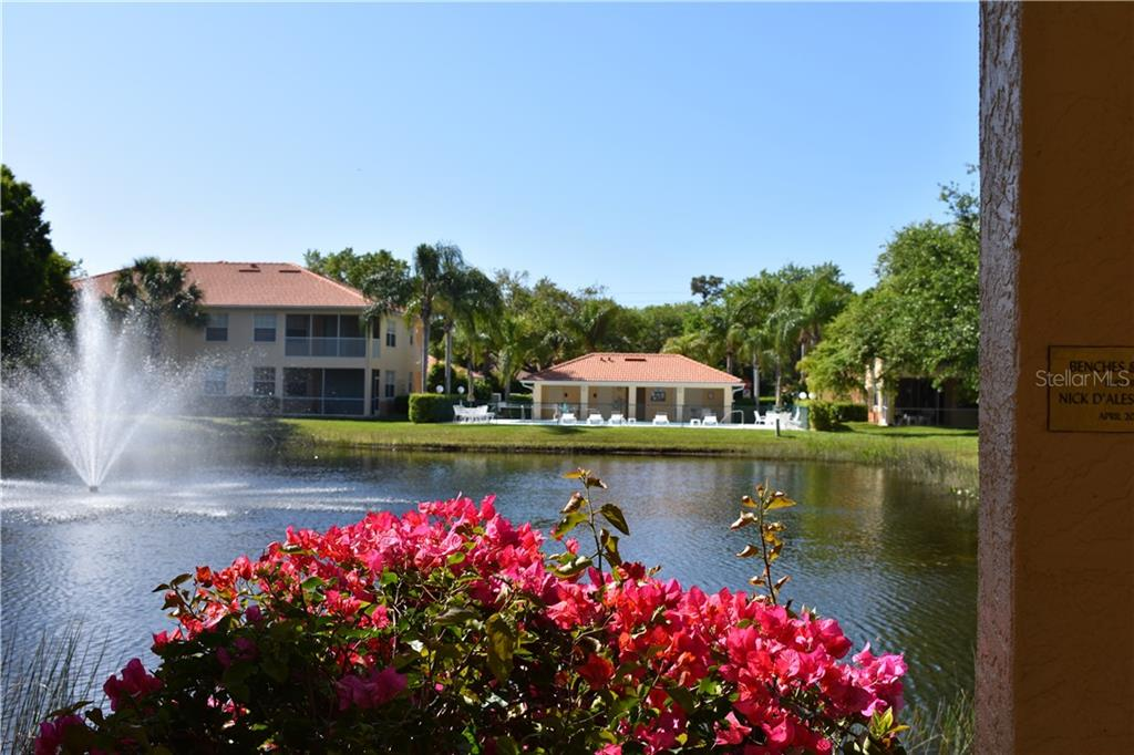 View from the gazebo looking across the lake to the community pool - Condo for sale at 904 Casa Del Lago Way #904, Venice, FL 34292 - MLS Number is N6105434