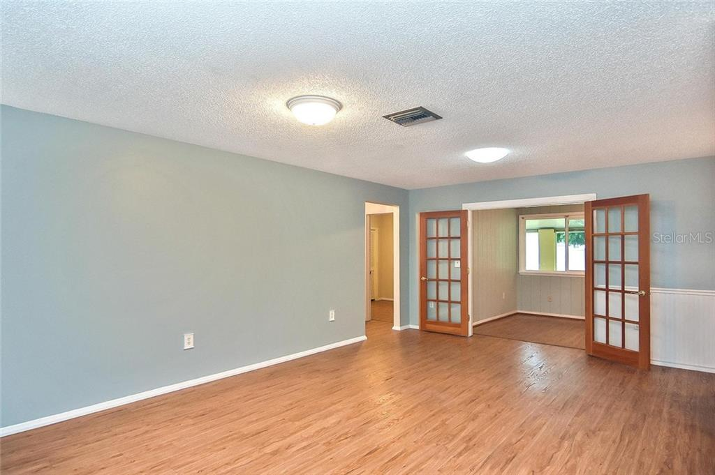 Living room to study/den - Single Family Home for sale at 1139 Ketch Ln, Venice, FL 34285 - MLS Number is N6105656