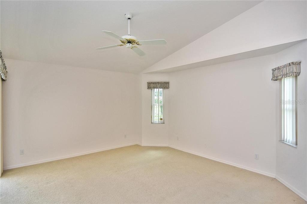 Master bedroom - Single Family Home for sale at 2232 E Village Cir, Venice, FL 34293 - MLS Number is N6105697