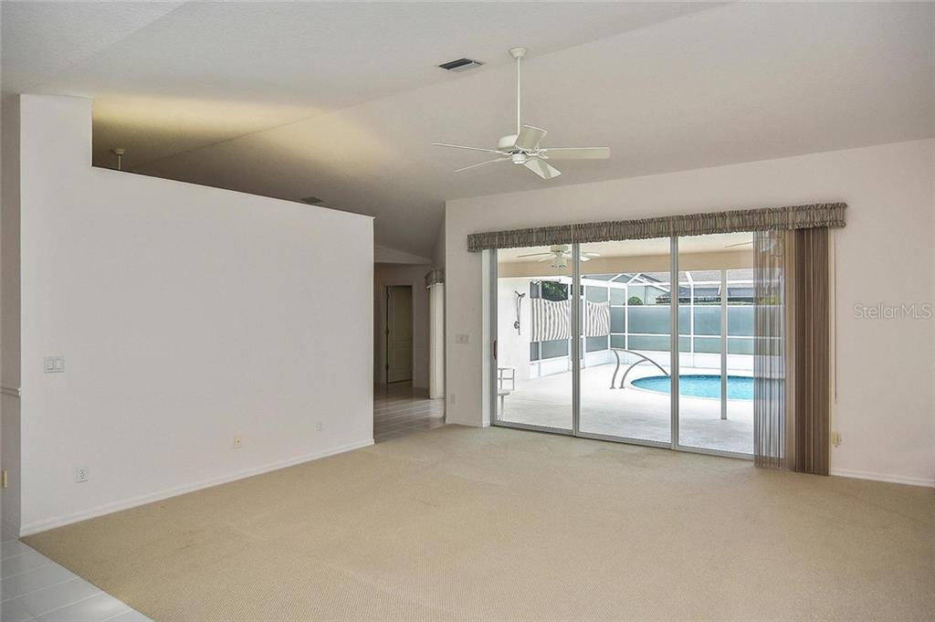 Great room to dinette/kitchen - Single Family Home for sale at 2232 E Village Cir, Venice, FL 34293 - MLS Number is N6105697