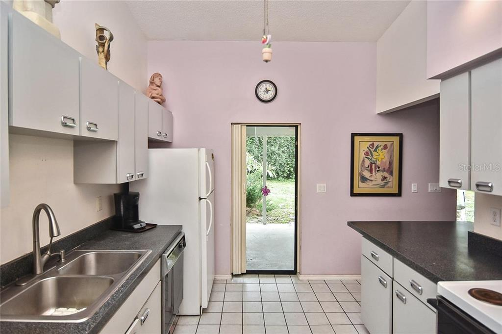 Kitchen - Single Family Home for sale at 125 Palm Ave E, Nokomis, FL 34275 - MLS Number is N6105973