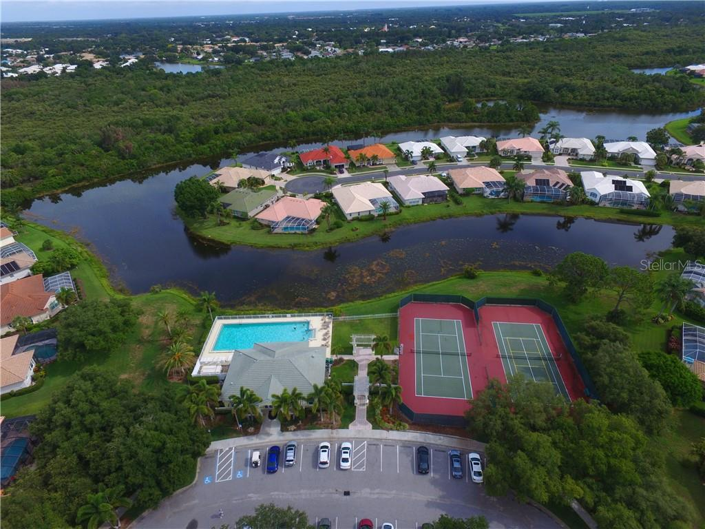 Aerial of community pool and tennis courts - Single Family Home for sale at 537 Lake Of The Woods Dr, Venice, FL 34293 - MLS Number is N6106043