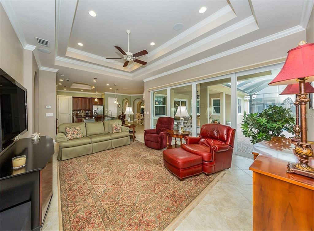 family room to ktichen - Single Family Home for sale at 189 Portofino Dr, North Venice, FL 34275 - MLS Number is N6106071