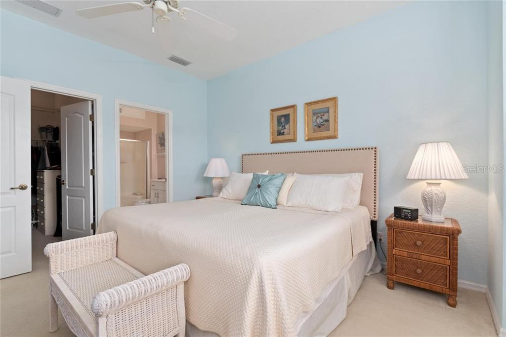 Master bedroom with large closet and master bath - Villa for sale at 1708 Fountain View Cir, Venice, FL 34292 - MLS Number is N6106422