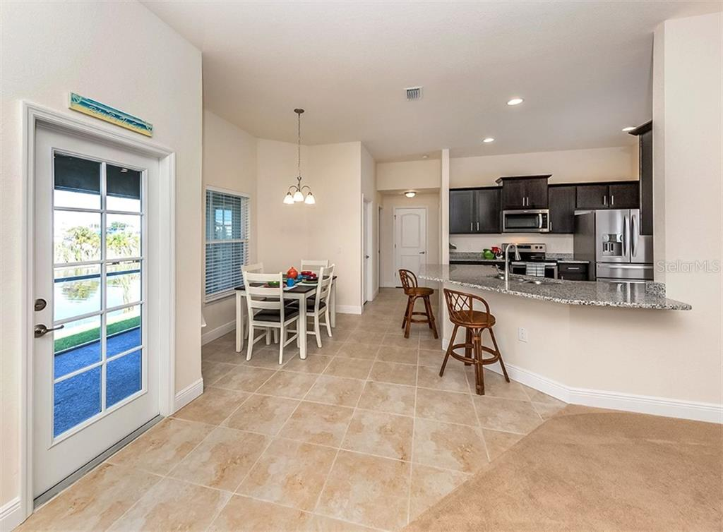 Breakfast nook, kitchen and breakfast bar - Single Family Home for sale at 10449 Redondo St, Port Charlotte, FL 33981 - MLS Number is N6107406