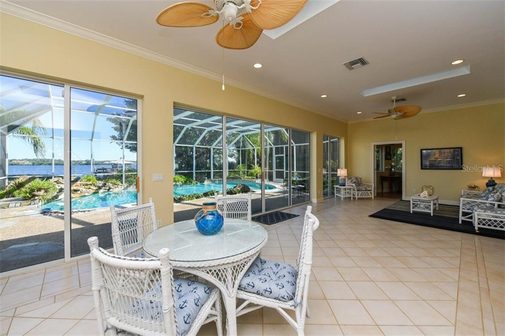 Living room extension - Single Family Home for sale at 7785 Manasota Key Rd, Englewood, FL 34223 - MLS Number is N6107786