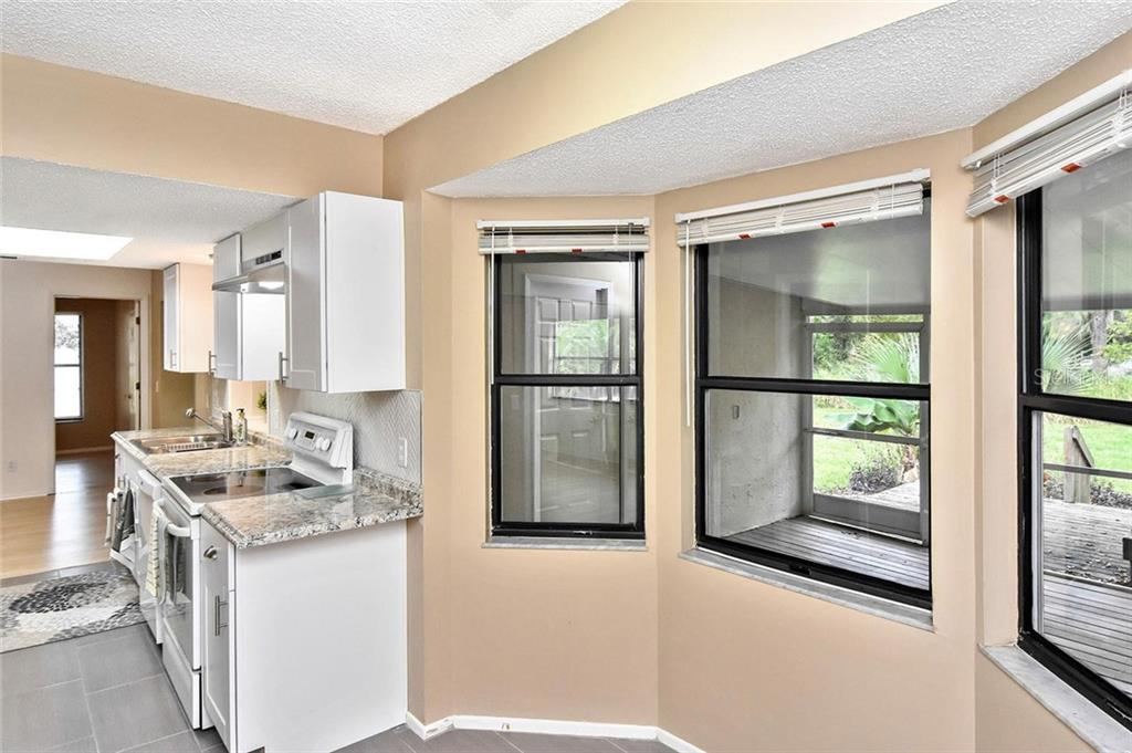 Dinette to kitchen - Single Family Home for sale at 5681 Hale Rd, Venice, FL 34293 - MLS Number is N6107822
