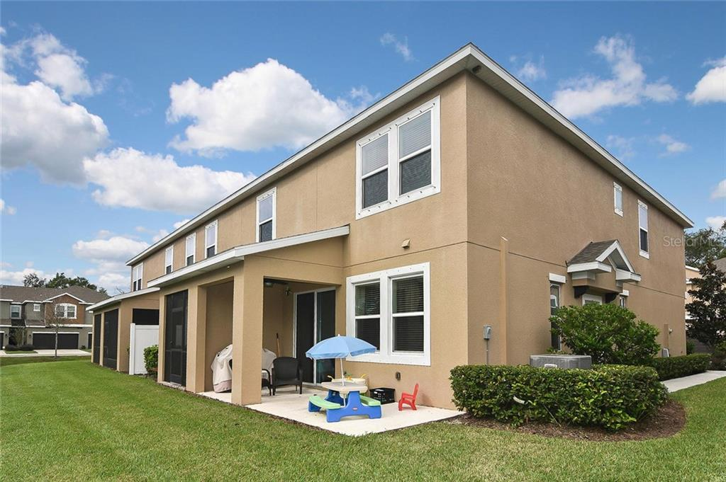 Rear exterior - Townhouse for sale at 10713 Avery Park Dr, Riverview, FL 33578 - MLS Number is N6107928