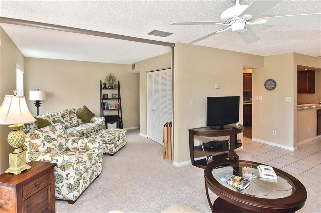 2nd bedroom from living room - Condo for sale at 626 Bird Bay Dr S #104, Venice, FL 34285 - MLS Number is N6107935