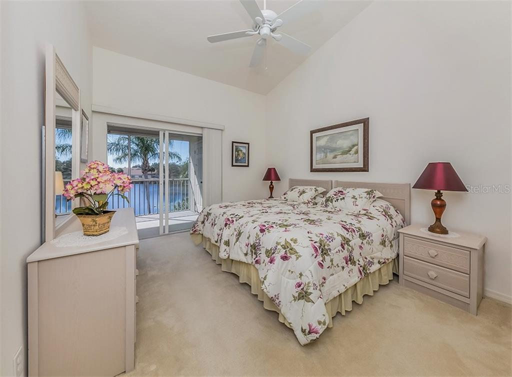 Bedroom with sliders to lanai - Condo for sale at 891 Norwalk Dr #205, Venice, FL 34292 - MLS Number is N6108169
