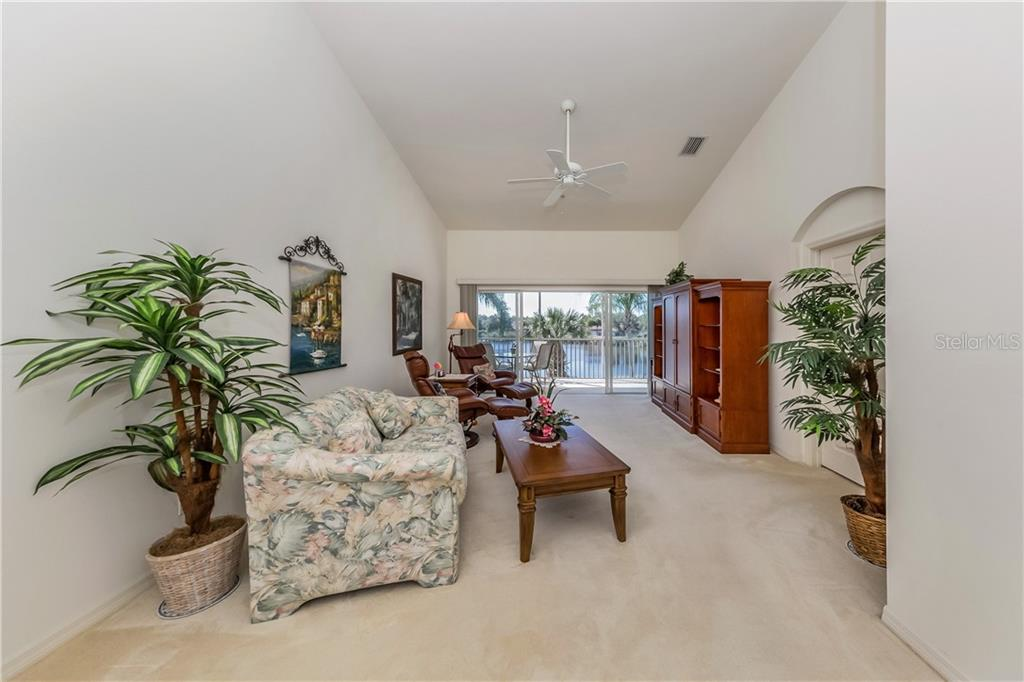Living room - Condo for sale at 891 Norwalk Dr #205, Venice, FL 34292 - MLS Number is N6108169