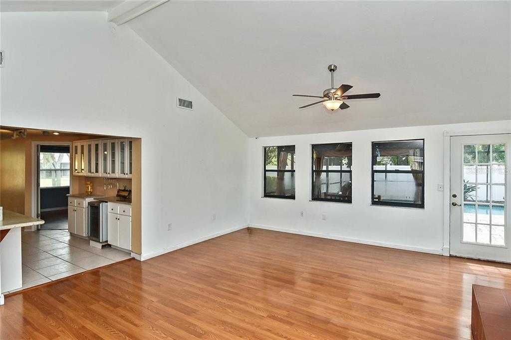 Family room to kitchen - Single Family Home for sale at 615 Lehigh Rd, Venice, FL 34293 - MLS Number is N6108175