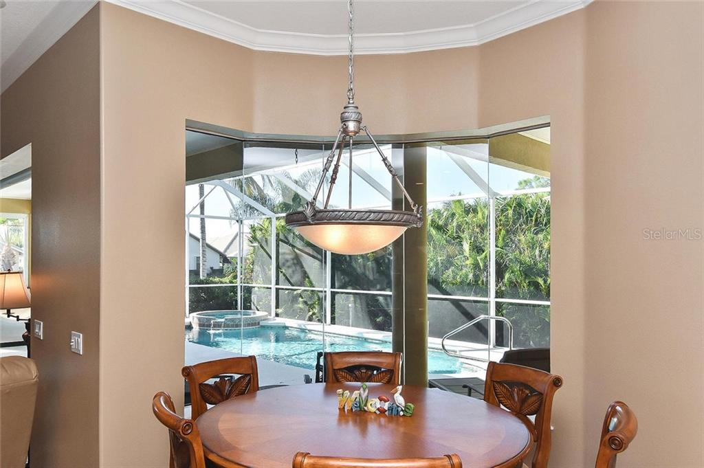 Dinette with view of pool - Single Family Home for sale at 321 Dulmer Dr, Nokomis, FL 34275 - MLS Number is N6108685