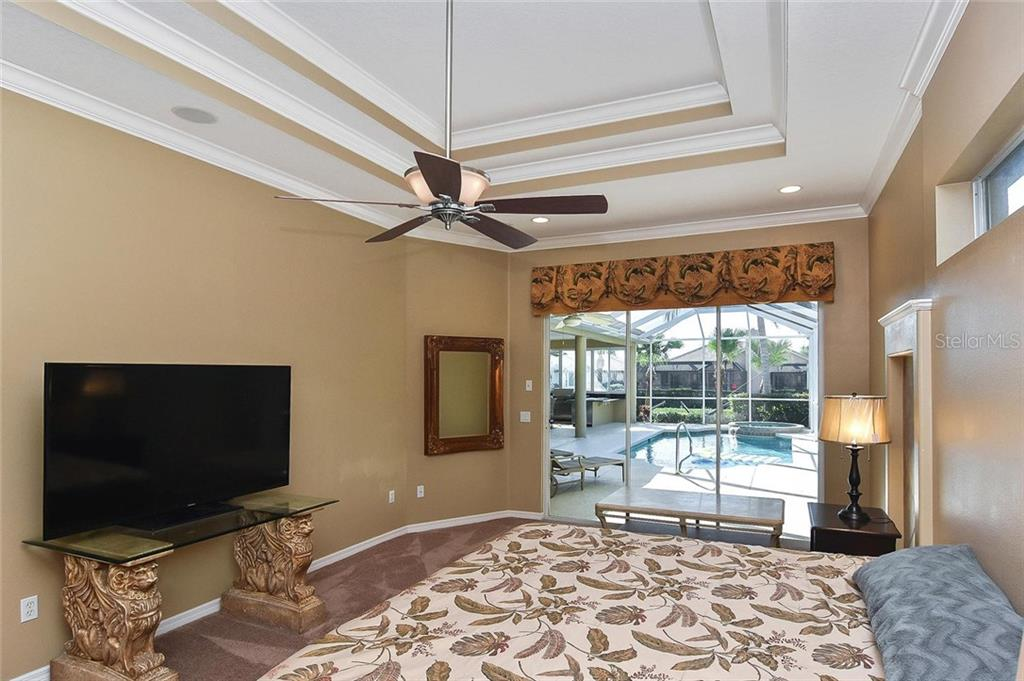 Master bedroom with slider to pool - Single Family Home for sale at 321 Dulmer Dr, Nokomis, FL 34275 - MLS Number is N6108685