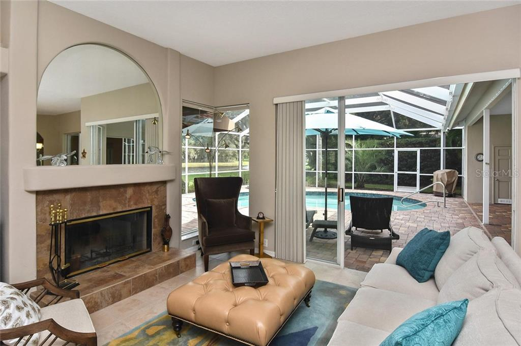 Family room with fireplace - Single Family Home for sale at 7185 N Serenoa Dr, Sarasota, FL 34241 - MLS Number is N6109058