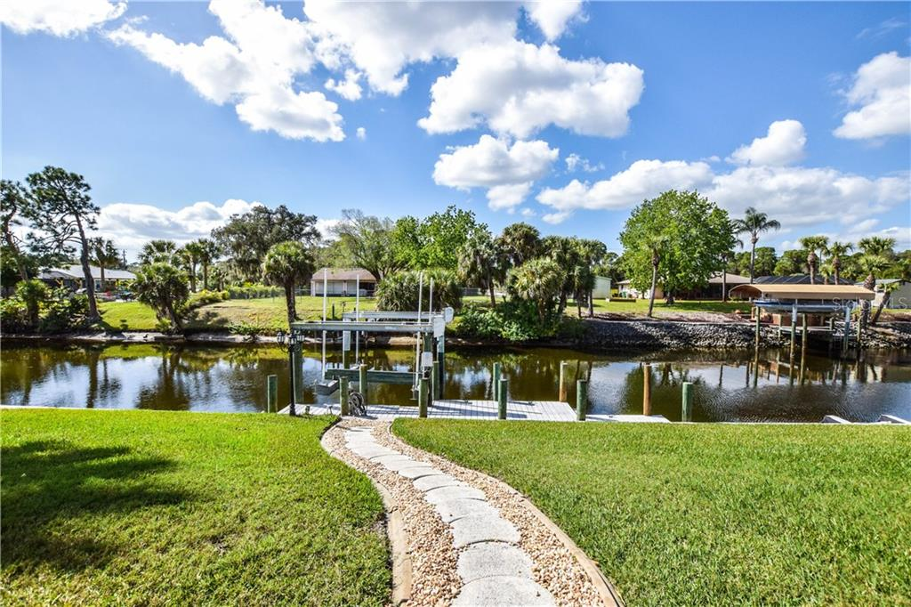 Path to boat dock and lift. - Single Family Home for sale at 2560 Pebble Creek Pl, Port Charlotte, FL 33948 - MLS Number is N6109100
